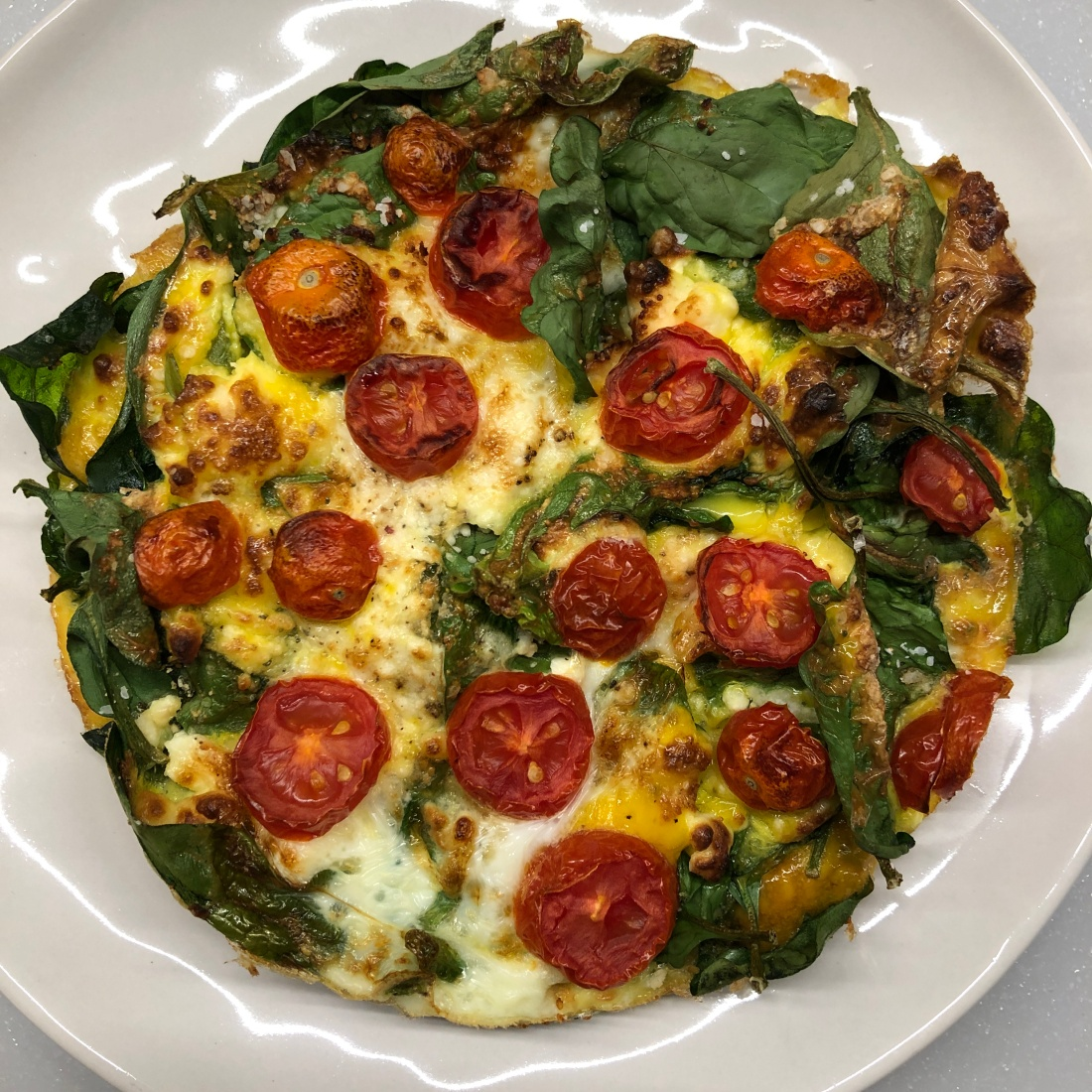 photo of a spinach, tomato, and feta frittata